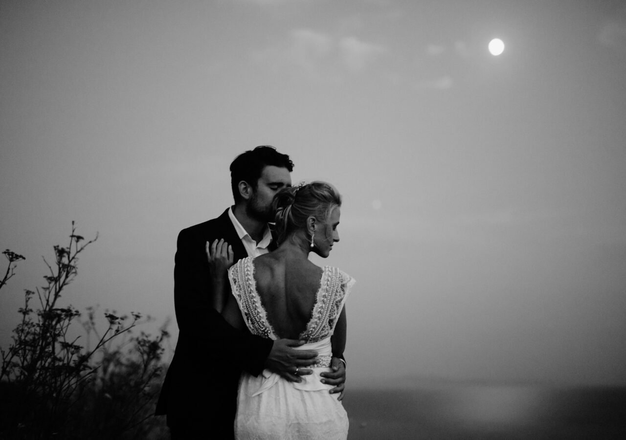 destination wedding photographer making dreamy black and white photo of bride and groom